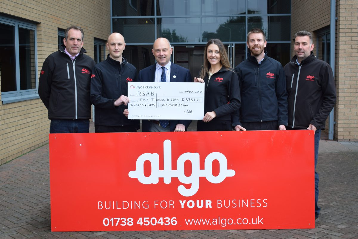 Algo handing over a cheque to the RSABI charity
